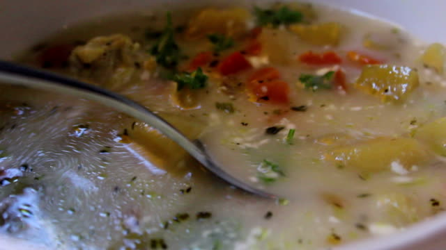 closeup of a spoon scooping soup - potato soup stock videos & royalty-free footage
