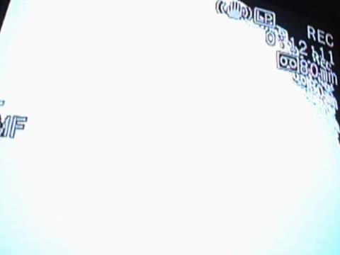 vídeos de stock e filmes b-roll de close-up of a static pattern on a screen - super exposto