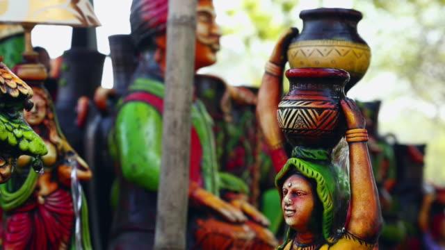 close-up of a statue in the fair, suraj kund, faridabad, haryana, india - haryana stock-videos und b-roll-filmmaterial
