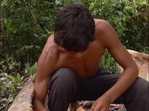 close-up of a teenage boy making a boat - endast en tonårspojke bildbanksvideor och videomaterial från bakom kulisserna