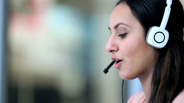Close-up of a telecaller talking on headset, Delhi, India
