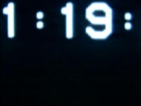 close-up of a timer on a black background - flüssigkristallanzeige stock-videos und b-roll-filmmaterial