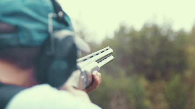 close-up of a trap shooter - tiro al piattello video stock e b–roll
