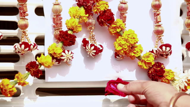 close-up of a truck driver's hand decorating his truck with flower, ballabgarh, haryana, india - decoration stock videos & royalty-free footage