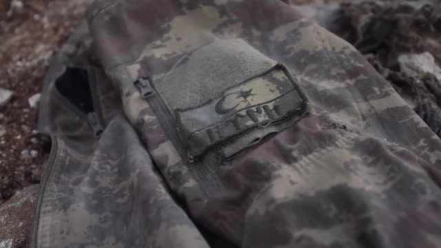 close-up of a turkish soldier's uniform after being killed in idlib - civil war stock videos & royalty-free footage