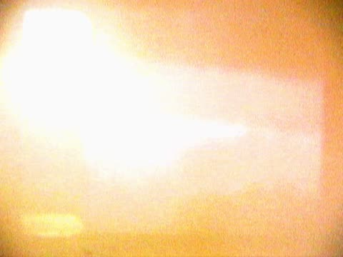 vídeos de stock e filmes b-roll de close-up of a white scrolling glow on a screen - super exposto