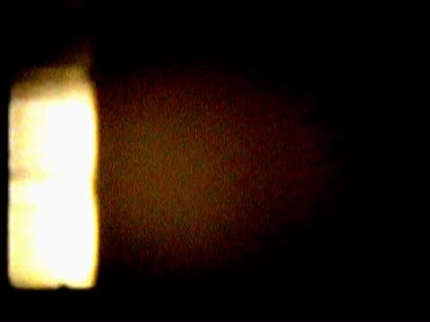vídeos de stock, filmes e b-roll de close-up of a white spot scrolling - concêntrico