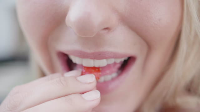 close-up of a woman eating strawberries. - zen like stock videos & royalty-free footage