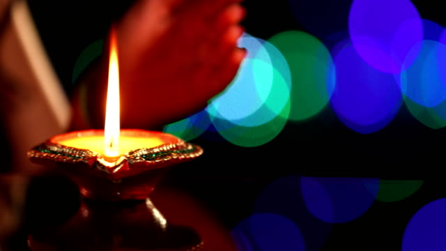 close-up of a woman hand protecting oil lamp, delhi, india - red nail polish stock videos and b-roll footage