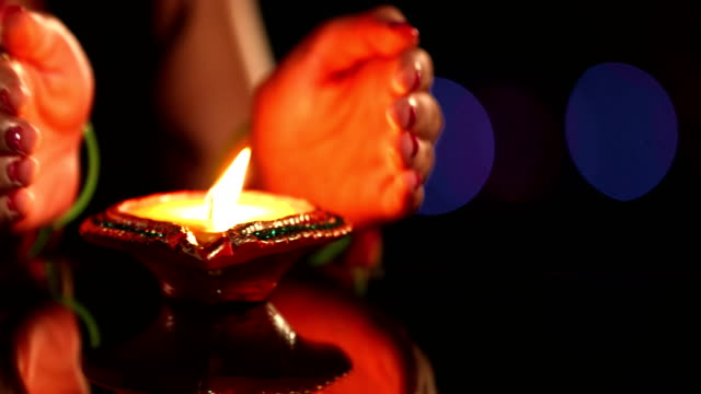 close-up of a woman hand protecting oil lamp, delhi, india - oil lamp stock videos & royalty-free footage