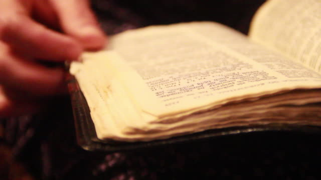 Close-up of a woman reading a bible and highlighting words. - Model Released - 1920x1080 - HD