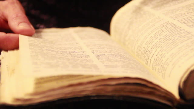 Close-up of a woman reading a bible. - Model Released - 1920x1080 - HD