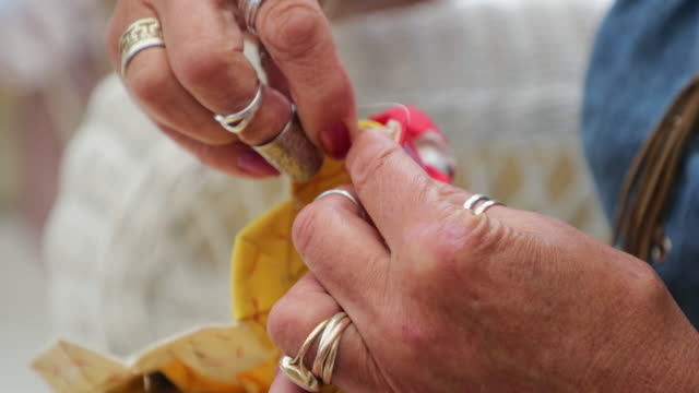 close-up of a woman stitching - quilt stock videos & royalty-free footage