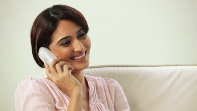 close-up of a woman talking on a cordless phone  - cordless phone stock videos & royalty-free footage