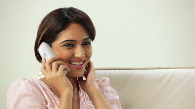 close-up of a woman talking on a cordless phone  - indian ethnicity stock videos & royalty-free footage