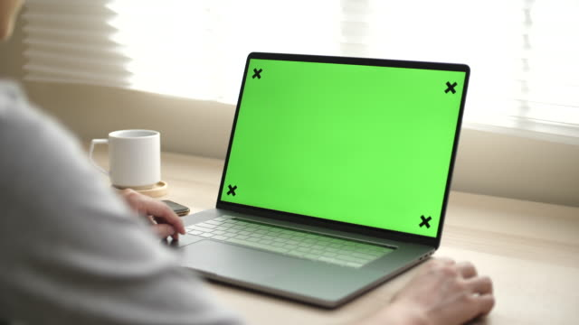 close-up of a woman uses laptop with green mock-up screen - laptop stock videos & royalty-free footage