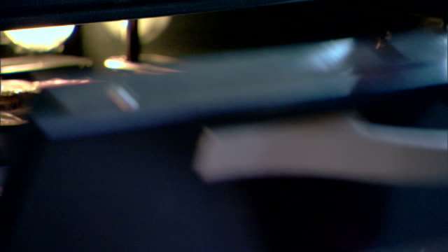 close-up of a woman?s hand removing a tv dinner from the oven. - oven mitt stock videos and b-roll footage
