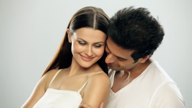 close-up of a young couple romancing - studio shot stock videos & royalty-free footage