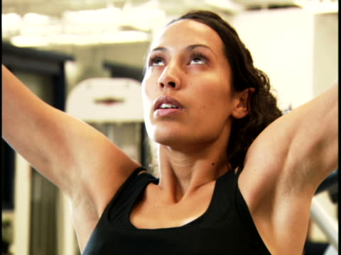 close-up of a young woman exercising - lateral pull down weights stock videos & royalty-free footage