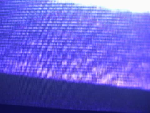 vídeos de stock, filmes e b-roll de close-up of abstract graphics on a screen - superexposto