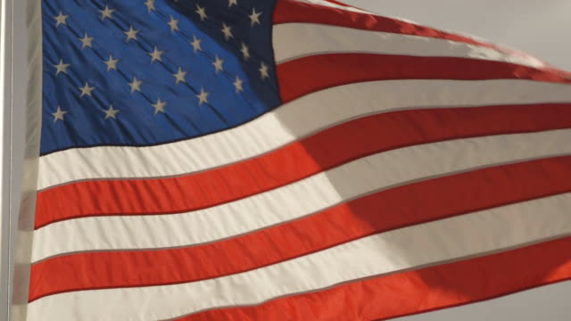 stockvideo's en b-roll-footage met close-up of an american flag flying in dc on a cloudy day - amerikaanse vlag
