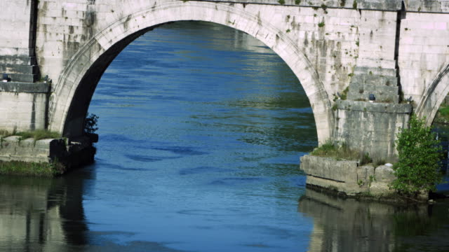 close-up of an arch underneath ponte sant'angelo - arch bridge stock videos & royalty-free footage