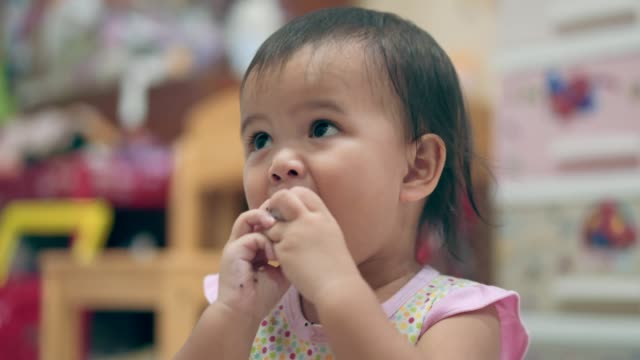 close-up of an asian baby girl eating dragon fruit - cute cactus stock videos & royalty-free footage