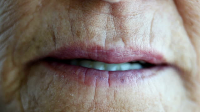 close-up of an elderly woman giving kisses - dental health stock videos & royalty-free footage