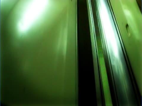 close-up of an elevator moving up - fahrstuhlperspektive stock-videos und b-roll-filmmaterial