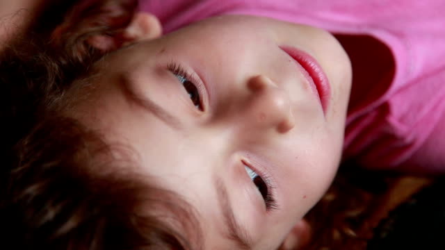 close-up of an emotional little girl lying on the back - lying on back stock videos & royalty-free footage