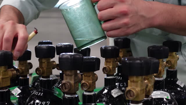 close-up of an employee checking cylinders of medical gas at chiyoda ltd. factory in asaka, japan on thursday, august 26, 2021. although covid deaths... - biochemistry stock videos & royalty-free footage