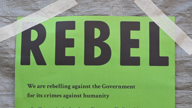 a closeup of an extinction rebellion sign as the environmental protest group ends day two of a series of protests collectively called 'project... - social movement stock videos & royalty-free footage