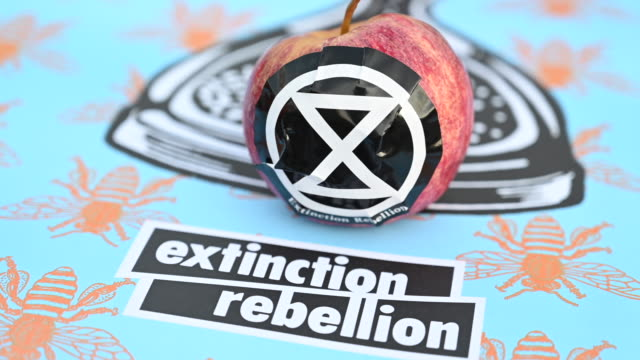 a closeup of an extinction rebellion sign as the environmental protest group ends day two of a series of protests collectively called 'project... - social movement stock videos and b-roll footage