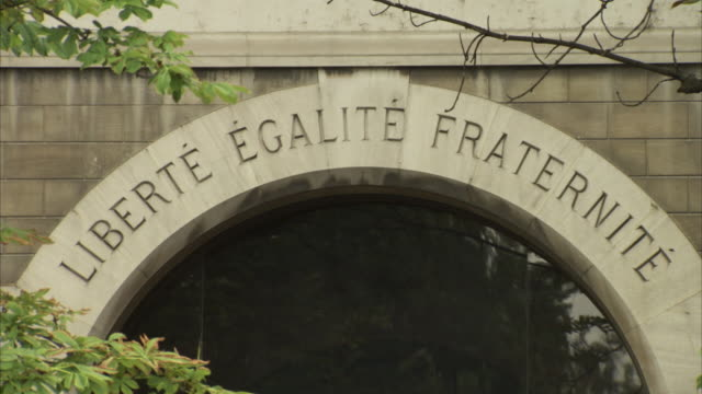 close-up of an inscription of the words 'liberté égalité fraternité' above a doorway near notre dame de paris, france. - french revolution stock videos & royalty-free footage