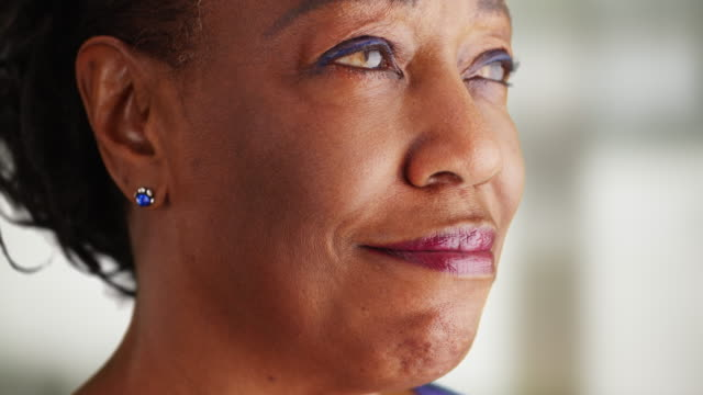 a close-up of an older black woman being very happy - candid stock videos & royalty-free footage