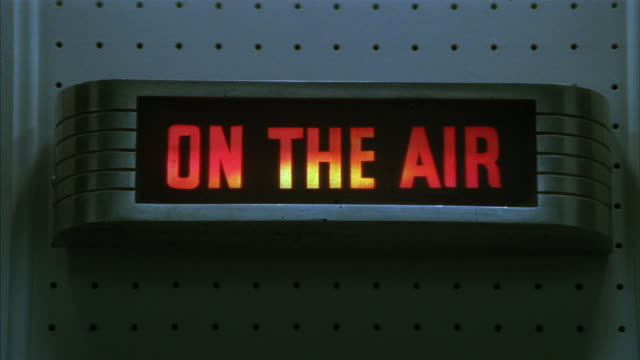 close-up of an on-the-air sign lighting up. - radio broadcasting stock videos & royalty-free footage