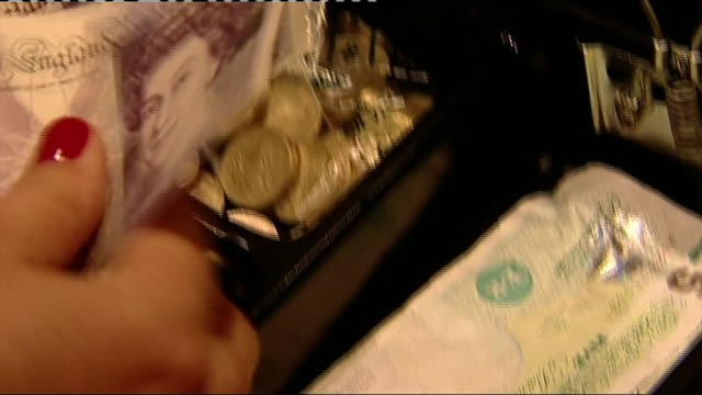 closeup of an open till and a cashier counting £20 notes before closing the drawer - open drawer stock videos & royalty-free footage