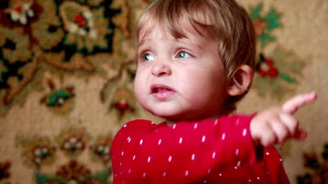 close-up of an unhappy baby girl pointing to the right - toddler stock videos & royalty-free footage