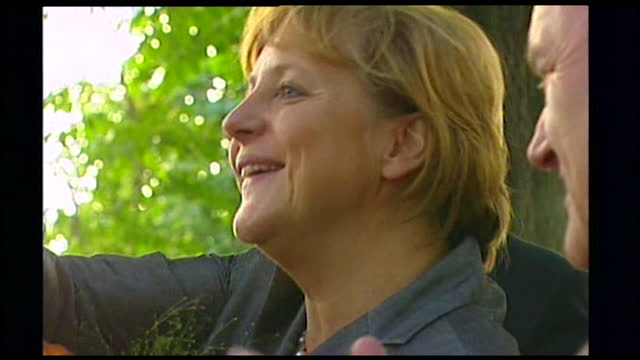 close-up of angela merkel smiling and accepting flowers; 2005. - 2000s style stock videos & royalty-free footage