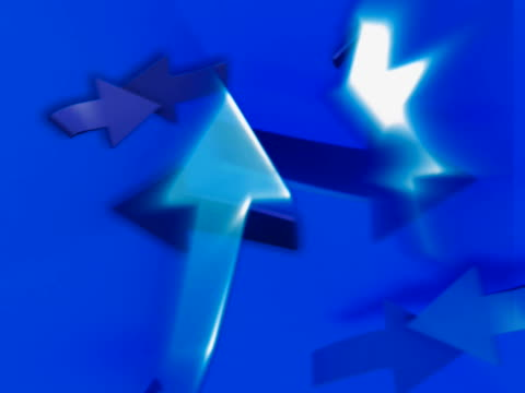 Close-up of arrow signs in motion on a blue background