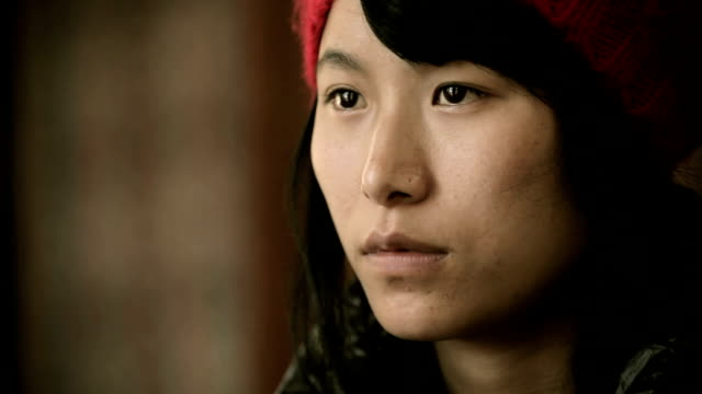 close-up of asian late teen girl thinking and looking away. - red cap stock videos & royalty-free footage