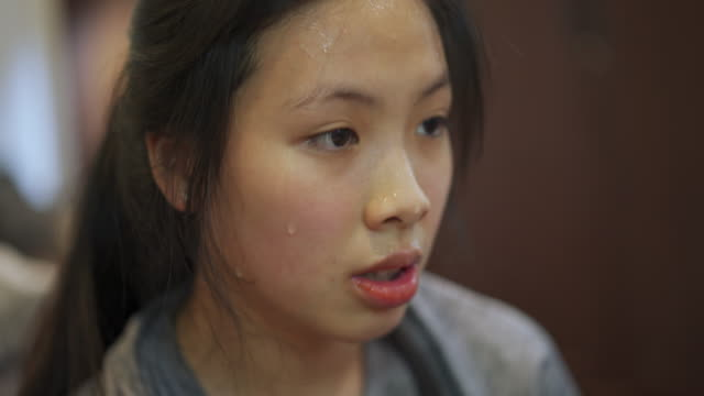 close-up of asian woman face sweating after doing workout exercise at home - inhaling stock videos & royalty-free footage