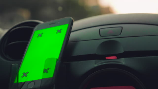 Close-up of asian woman using smartphone in car,Green screen