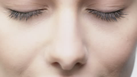close-up of attractive woman opening her blue eyes - eyelash stock videos & royalty-free footage