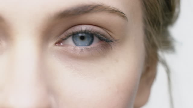 close-up of attractive woman with blue eyes - beauty stock videos & royalty-free footage