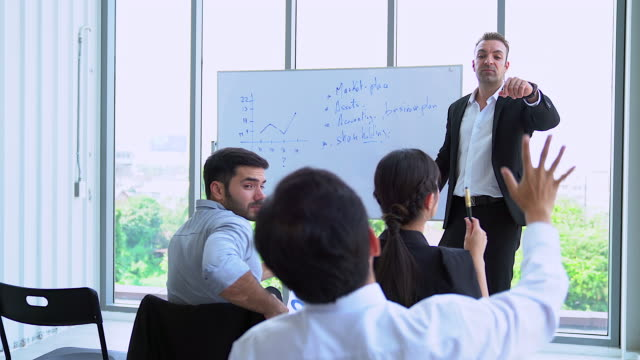 closeup of audience listening speaker in the business seminar. professional education, work meeting, presentation or coaching concept. - oratore pubblico video stock e b–roll