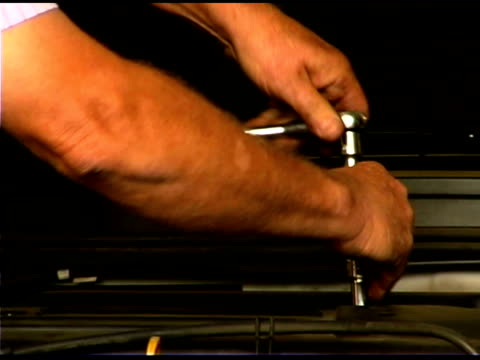 close-up of auto mechanic repairing engine - only mature men stock videos & royalty-free footage