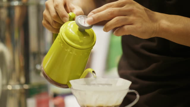 Close-up of barista's hand is doing coffee drip-small business of craft product