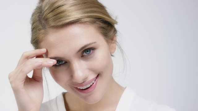 close-up of beautiful smiling shy woman - shy stock videos & royalty-free footage