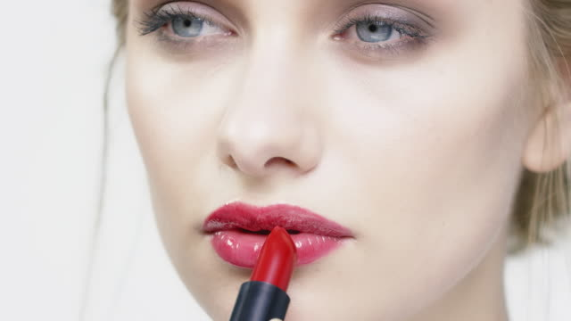 close-up of beautiful woman applying red lipstick - make up stock videos & royalty-free footage